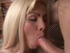 Ponytailed blonde tranny bitch sucking a massive penis with lust